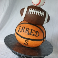 It's A Ball! Life size basketball, football and baseball cake.