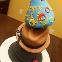 Silly Hats Top hat, cowboy hat and a birthday hat covered in fondant This was my 1st topsy cake Iave ever made!