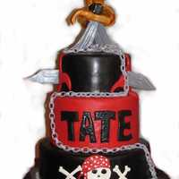 10Th Birthday Pirate Theme Choc cake with choc frosting. Chain made from 3/1 gum paste/fondant, 180 links.