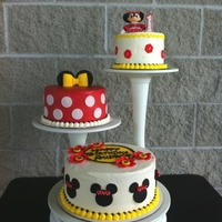 Minnie Mouse Cakes Buttercream with fondant accents Minnie is fondant as well. All edible. I made this for my niece's 1st birthday.