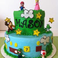 Mario Brothers Cake Buttercream with fondant accents and toys