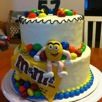 Peanut M&m Birthday Buttercream with fondant M&M figure and package. Real peanut M&m's