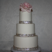 3 Tier Fondant Wedding Cake With Pink Gunpaste Peony And Rhinestone Ribbon 3 tier fondant wedding cake with Pink gunpaste peony and rhinestone ribbon