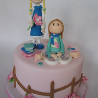 Two Birthday Girls, One Cake  Made this cake for two sisters celebrating their birthday together. They are wearing there birthday outfit en are surronded by there...