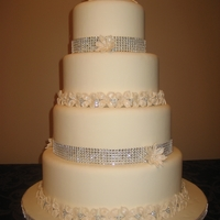 4 Tier Wedding Cake With Flowers And Diamond Wrap