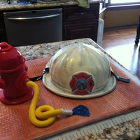 Fire Fighter   Fire helmet, fun project, first fire helmetMake with soccer ball pan, fondant, rice Krispy, more fondant