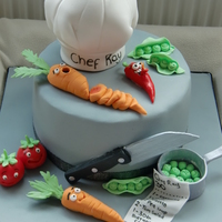 Chef Cake This was for a Chef that travels the world cooking for people. Loved making the little faces :)