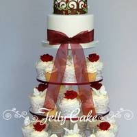 Burgundy Birdcage Cupcake Tower A cupcake tower and top cutting birdcage cutting cake designed around the wedding theme of birdcages, butterflies and burgundy roses.