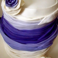 Purple Ribbon Wedding Cake layers of sugar paste to create ribbon / ruffle effect