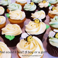 What Could It Bee? A Boy Or A Girl? Gender reveal party cupcakes with little modeling chocolate bees.