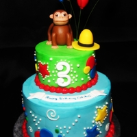 "Curious George 6"" 2 layer cookies n cream cake with a 4"" top tier covered in buttercream with a fondant hat, monkey and balloons"