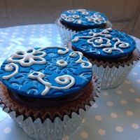 Caramel Mud Cupcakes Choc top, caramel mud cupcakes.... I had fun hand painting the embossed deign with silver luster dust and piping the pattern with royal...