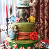 Alice In Wonderland Wedding Cake  The cards and the cake with the scene are icing sheets with edible printing. The teapot is a cake and the roses are all made fondant, the...