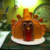 Turkey Cake!   pumpkin cake with part maple buttercream and part chocolate buttercream.