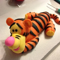 Tigger Tigger out if 1/2 gum paste 1/2 fondant , I saw this YouTube video that helped me how to make him really easy :