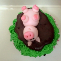 Happier Than A Pig In Mud   This is my own version of Victoria's kitchen piggy cupcake. I wish I had the grass tip to make this look better.
