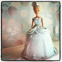 Cinderella Doll Cake cake is strawberry with whipped chocolate ganache filling. Covered her in a ice blue fondant and white flowers.