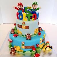 Its Mario And Luigi! I loved making this cake! Reminded me of my childhood! Everything is edible and handmade!