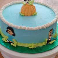 Peanuts Cake Vanilla cake with whipped frosting. The characters are made of chocolate.