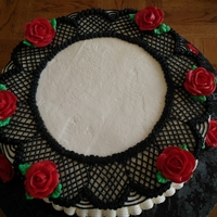 Black Lace Cake This is a black on white cake. Its all decorated with vanilla whipped icing. The flowers are made with decorators icing.