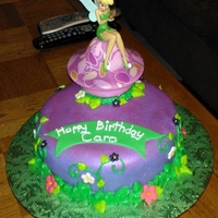 Tinker Bell Cake This is a french vanilla cake covered in vanilla/whipped buttercream and fondant. The flowers are made of fondant and the leaves and vines...