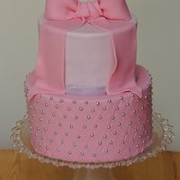 Pink Bow And Quilting Chocolate cake with chocolate buttercream filling. Sugarpaste bow and quilting.