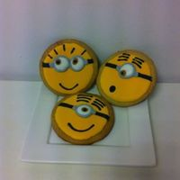 Despicable Me Cookies First time for everything.... First Minion Cookies. They are still a bit messy, despite the template I used for the round circel.