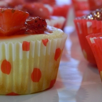 Strawberry Cheesecake Cupcakes (Minis) Mini cheesecake cupcakes topped with fresh Strawberries and fresh syrup!