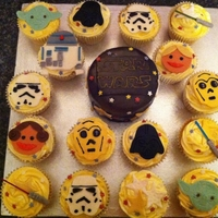 Star Wars I made this for my nephew's 4th birthday - The bigger cake is chocolate filled with chocolate frosting and fondent. The cupcakes are...