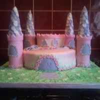 Fairytale Castle First attempt at using fondent and cake covering! Was very happy with this although it took the best part of 13 hours!