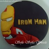 Iron Man Birthday Cake   Chocolate Cake covered with Marshmallow fondant. All designs including iron man are crafted from Marshmallow fondant.