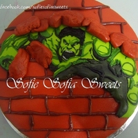 Hulk Birthday Cake   Chocolate cake covered with fondant. All designs, including hulk are made and drawn using marshmallow fondant.