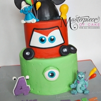 Mickey Mouse, Smurfs, Cars And Monster & Co. Themed Birthday Cake Mickey Mouse, Smurfs, Cars and Monsters Inc. themed birthday cake for a boy that could choose one theme!