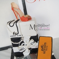 Fashionista Birthday Cake Manolo Blahnik shoe(box), Chanel giftbox, Hermes box and Vogue magazine cake. All decoration and details are edible!