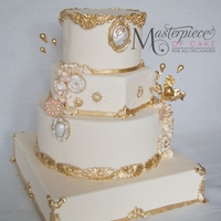 Marie-Antoinette Inspired Wedding Cake Marie-Antoinette Inspired Wedding Cake. All edible decoration and handpainted gold details.