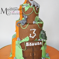 Dinosaur Themed Birthday Cake Original design by Little Cherry Cake Company.
