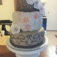 This Is A Three Tier Dark Chocolate Cake With Caramel Buttercream All Flowers Are Gumpast With Piping On The Top And Bottom Tier With The M... This is a three tier dark chocolate cake with caramel buttercream. all flowers are gumpast with piping on the top and bottom tier with the...