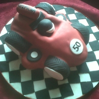 Racing Car I made this for my friend's 50th Birthday. Chocolate Cake with Chocolate Butter Cream filling