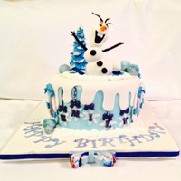 Disney's Frozen Cake..olaf On An Icy Pond All edible and custom made to order...Ice pond made of icing gel, with ice cubes made of blue jello...isomalt used to make candy made are...