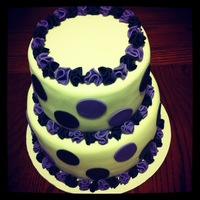 "Black And Purple Circles And Ruffles Bottom Is 8 And Top Is 6 Vanilla Cake With Vanilla Frosting Covered In Mmf And Mmf Decor Black and Purple circles and ruffles. Bottom is 8"" and top is 6"". Vanilla cake with vanilla frosting. Covered in MMF and MMF..."