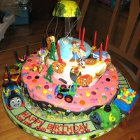 Toy Story Thomas Topsy Turvy Cake So - this is a creation made for my boys 5th and 6th birthdays. They are only 2 days apart so we combine the cake. One liked Toy Story the...