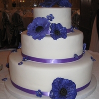 Purple Anemone Wedding Cake A friend from work was nice enough to trust me with the most important cake of her life. I'd never made a wedding cake, I'd never...