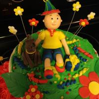 Cailou I made this cake for a little girl who loves caillou! The mother gave me a picture of a cake that she found online that had a feminine look...
