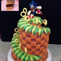 Sonic Green Hill Zone Cake ~ 3 tiers : 5'', 7'', 9'' round pan, each tier composed by :2 layers of Orange flavoured cake and 1 layer...