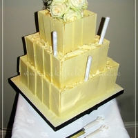 White Choc Panels Wedding Cake  3 tier wedding cake: 12, 9 and 6in. Each tier 4.5in high. There's 3 the same cakes, and the cake itself is 4 layers of genoise sponge...