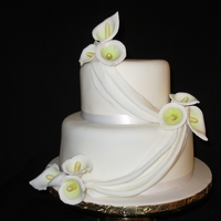 Calla Lilies Cake 2 tier chocolate cake covered in white fondant with gumpaste calla lilies