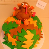 Happy Thanksgiving! used fondant and a leaf cookie cutter. the turkey is also made out of fondant