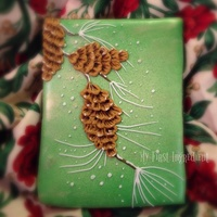 Seasons Greetings Cookie Sugar cookie royal iced and airbrushed. The pine cone is brushed embroidery royal icing