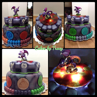 Skylanders Birthday Cake Made for a kid at church. Cake is chocolate with chocolate buttercream. Top tier is cake with rice krispies treats for the details like the...