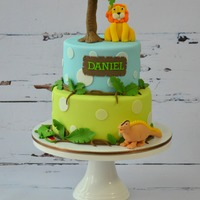 Jungle Theme Cake a jungle theme cake for a birthday party with a lion, crocodile and dinosaur- all favourite animals of the birthday boy!